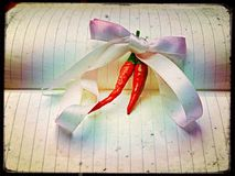 Chillies in bow tie ribbons Stock Photo