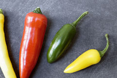 Chillies on Dark Background from above. Stock Photos