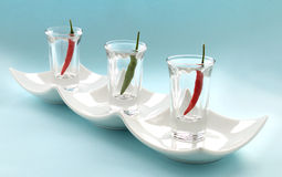 Chillies In Glasses Stock Photos