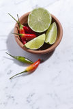 Chillies And Limes Royalty Free Stock Images