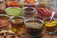 Various spices for dishes on wooden boards, camera from above stock photography