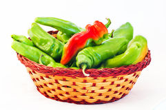 Chillies. Red and green hot peppers in a rustic wicker basket Royalty Free Stock Photo