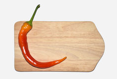 Chillies, red pepper on wooden board Stock Images