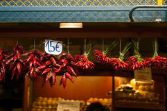 Chillies on sale. A row of chillies and paprika hanging from the roof some are dry and some are fresh costing cheap 1,5 euros Stock Images