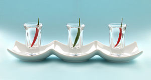 Chillies In Shot Glasses Royalty Free Stock Photos