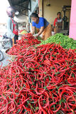 Chillies. Traders sorting chillies at a market in the city of Solo, Central Java, Indonesia stock photo