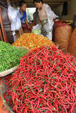 Chillies. Traders sorting chillies at a market in the city of Solo, Central Java, Indonesia stock photos