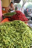 Chillies. Traders sorting chillies at a market in the city of Solo, Central Java, Indonesia royalty free stock image