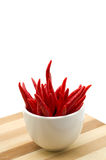 Chillies in a white bowl. On white background Royalty Free Stock Photo