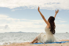 Chilling on the beach. Asian lady chilling on the beach Stock Photo