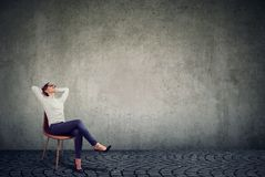 Chilling businesswoman sitting on chair royalty free stock images