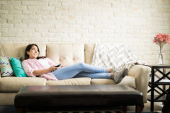 Chilling at home watching tv Royalty Free Stock Image