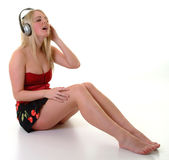 Chilling Out. Young female listening to music on headphones Stock Image