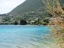 Chilling out at the beach in Lefkada, Greece. Holiday with beautiful weather in a country village. stock images