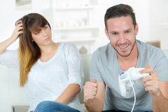 Chilling out at home with games console Stock Image