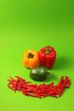 Chillis e paprika vermelhos Imagens de Stock Royalty Free