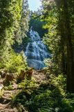 Chilliwack, CANADA - JULY 14, 2018: People in Bridal Veil Falls Provincial Park British Columbia Canada summer day. Chilliwack, CANADA - JULY 14, 2018: People stock photography