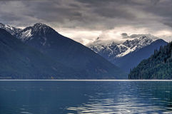 Chilliwack lake landscape with a log and mountains stock photo