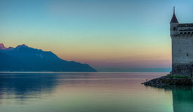 Chillon Castle by the lake at sunrise Royalty Free Stock Image