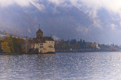 Chillon Castle. SWITZERLAND - NOVEMBER 06, 2014: , one of the most visited castles in Switzerland and Europe, is in the hazy, cloudy midday Royalty Free Stock Image