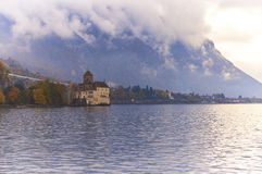 Chillon Castle. SWITZERLAND - NOVEMBER 06, 2014: , one of the most visited castles in Switzerland and Europe, is in the hazy, cloudy midday Royalty Free Stock Photo