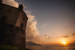 Chillon Castle in Switzerland during the sunset. Royalty Free Stock Photography
