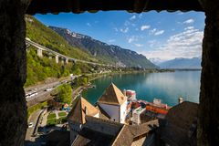 Chillon castle in window frame - Veytaux, Switzerland. Lake and mountain landscape of Chillon castle in window frame - Veytaux, Switzerland royalty free stock photo