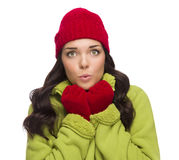 Chilly Mixed Race Woman Wearing Winter Hat and Gloves Stock Photo
