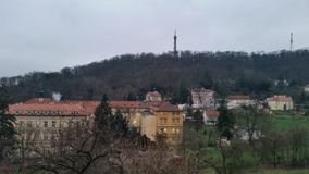 Chilly Prague. The tower and old buildings Royalty Free Stock Image