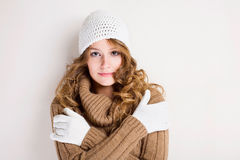 Chilly winter fashion girl. Portrait of a beautiful chilly winter fashion girl in turtleneck sweater stock photo