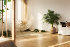 Chillzone in loft. Natural hipster chillzone with sand and hammock in elegant stylish loft royalty free stock photo