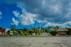 CHILOE, CHILE - SEPTEMBER, 27, 2018: Outdoor view of a park with some wooden buildings and church located in Chacao in royalty free stock image