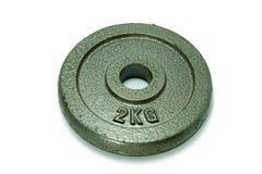 2 chilogrammi dell'attrezzatura rotonda di forma fisica Fotografia Stock