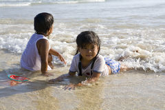 Chilren swimming in the sea. Two little Thai children swimming and playing in the sea Royalty Free Stock Photo