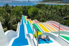 Chilren water slides in Aqua park by the sea.  Royalty Free Stock Images