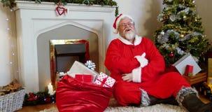 Chimenea que se sienta de Papá Noel y canto metrajes