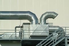 Chimenea y tubos en planta Imagen de archivo