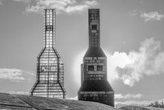 Chimeneas de la Cidade da Cultura, blanco y negro. Cidade da Cultura, chimneys Black and white, in a sunrise winter morning Stock Images
