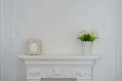 Chimeneas y flores Marco de la foto Foto de archivo libre de regalías