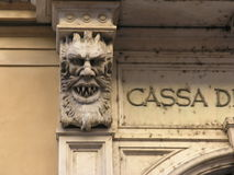 Chimera. Support of a balcony carved as a beast royalty free stock photography