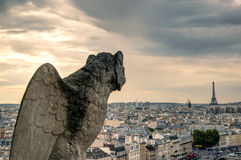 Chimera of the Cathedral of Notre Dame de Paris overlooking the Royalty Free Stock Photos