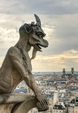 Chimera of the Cathedral of Notre Dame de Paris overlooking Pari Royalty Free Stock Photography