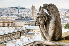 Chimera of the Cathedral of Notre Dame de Paris overlooking Pari Stock Photography