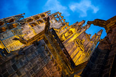 Chimera. Hang from the walls of the old cathedral at night Stock Photo