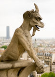 Chimera of Notre Dame de Paris. Close up of gargoyle on Notre Dame Cathedral Royalty Free Stock Photography