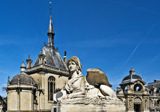 Chimera statue in entrance to Chantilly castle. Architectural details of the castle are at background Stock Photo