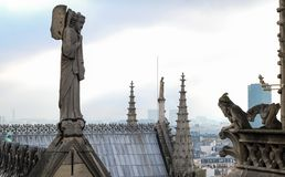 Chimeras gargoyles of the Cathedral of Notre Dame de Paris overlooking Paris royalty free stock images