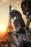 Chimeras in Paris. Chimeras on Notre Dame de Paris and Eiffel Tower, France royalty free stock photography