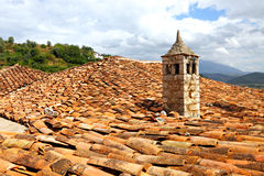 Chimey on red clay shingles roof royalty free stock photos