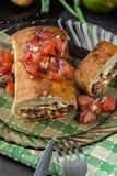 Chimichanga mexicano com mergulho da salsa fotos de stock royalty free
